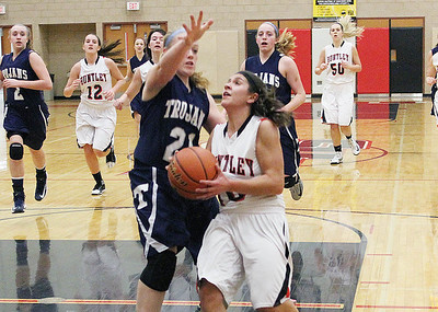 (Don Lansu for the Northwest Herald.Huntley's Kayla Barreto (10 drives to the hoop on the breakaway as  Cary-Grove's Sarah Kendeigh ((21)defends druing varsity action at Huntley H.S. 1/12/2012.