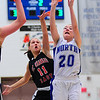 Sam Novak of St. Charles North shoots for the basket against St. Charles East's Carly Pottle on Saturday, Jan. 12.