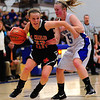 St. Charles East's Amanda Hilton pushes past St. Charles North's Natalie Winkates at North High School Saturday, Jan. 12.