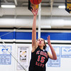 Kyra Washington of St. Charles East shoots for the basket during the St. Charles North vs. St. Charles East girls basketball game at North High School Saturday, Jan. 12.