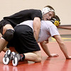 Batavia wrestler Mickey Watson (top) runs drills with teammate Noah Frazier during practice Thursday afternoon.