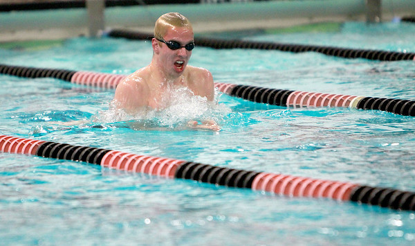 St. Charles East swimmer T.J. Bindseil swims the 100-yard breaststroke during their dual meet Thursday against Waubonsie Valley.