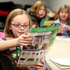 Rylie Flatt, 8, a member of Brownie Troop 4106, goes over her Girl Scout cookie sale form during the troop's meeting at the Sugar Grove Library.