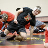 Batavia wrestler Mickey Watson warms up with his team during practice Thursday afternoon.