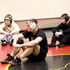 Batavia wrestler Mickey Watson (center) takes a break during practice Thursday with teammates Charlie Smorozewski (right) and Joel Shump.
