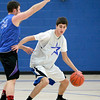 St. Charles North senior Kyle Swanson dribbles around teammate Matt Pretet during practice at the school Wednesday afternoon.