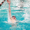 St. Charles East swimmer John Tarpey swims the 100-yard backstroke during their dual meet Thursday against Waubonsie Valley.