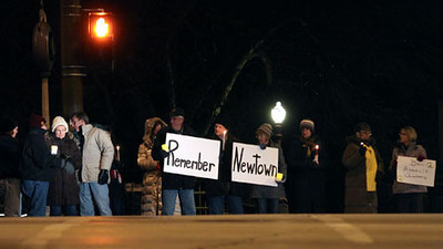 Jeff Krage — For the Kane County Chronicle<br /> A candlelight vigil to remember Newton was held Monday evening at the corner of Batavia Ave. & Wilson St.  <br /> Batavia 1/14/13
