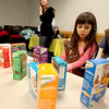 Sandra Bach and Natalie Dee, members of Brownie Troop 4106, look at the different flavors of Girl Scout cookies available for sale this year during their meeting at the Sugar Grove Library.