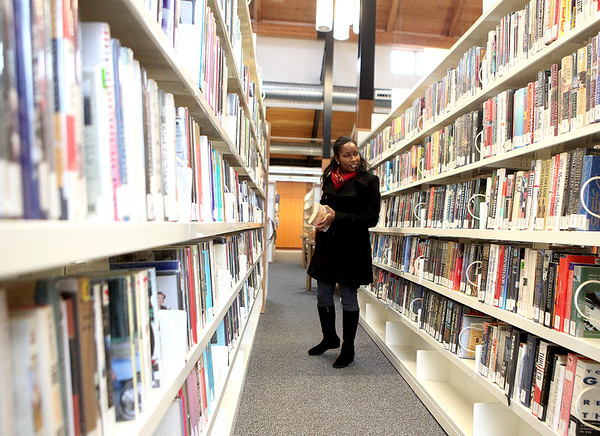 Edwinna Johnson of Sugar Grove browses the aisles at the Sugar Grove Library. The library now has expanded its days of operation to include Sunday and Monday.