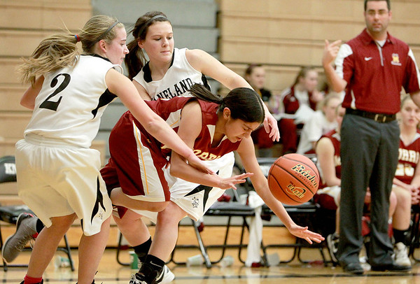 Kaneland's Sarah Grams (2) and Allyson O'Herron battle a Morris player for the ball during their game in Maple Park Tuesday.