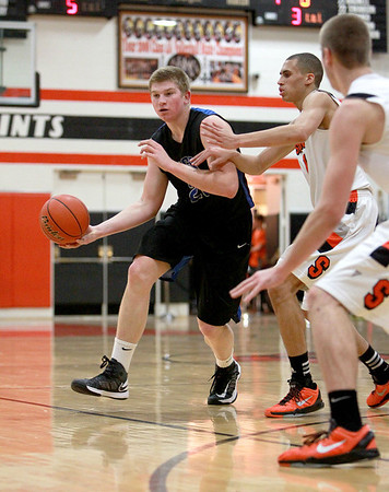 St. Charles North's Justin Stanko passes the ball during their game at St. Charles East Friday night.