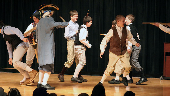 Jeff Krage — For the Kane County Chronicle<br /> George Washington and other 7th-grade patriots capture British soldiers during Friday's Patriots Day events at Geneva Middle School North.<br /> Geneva 1/18/13