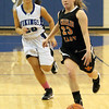 Jeff Krage — For the Kane County Chronicle<br /> St. Charles East's Amanda Hilton leads a fast break while being chased by Geneva's Kelly Gordon during Friday's game in Geneva.<br /> Geneva 1/18/13