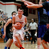 St. Charles East's Dom Adduci goes up for a layup during their home game against St. Charles North Friday night.