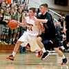 St. Charles East's Cole Gentry (44) tries to get past Alec Goetz of St. Charles North during their game at East Friday night.