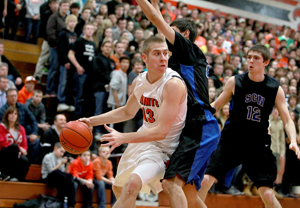 St. Charles East's Ben Skoog looks to pass the ball to a teammate during their home game against St. Charles North Friday night.