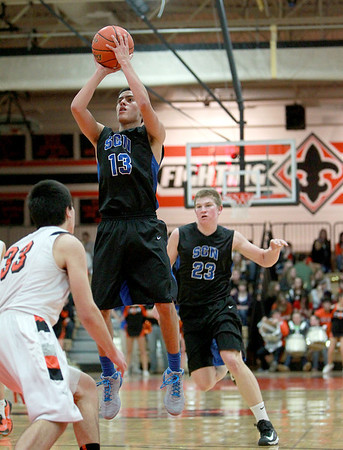 Tony Neari of St. Charles North puts up a shot during their game at St. Charles East Friday night.