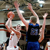 St. Charles East's Dom Adduci puts up a shot during their home game against St. Charles North Friday night.