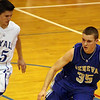Jeff Krage – For the Kane County Chronicle<br /> Geneva's Pace Temple is guarded by Larkin's Taylor Boley during Saturday's game in Elgin.<br /> Elgin 1/19/13