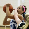 Jeff Krage — For the Kane County Chronicle<br /> Geneva's Kelly Gordon attempts a shot while being defended by St. Charles East's Hannah Nowling during Friday's game in Geneva.<br /> Geneva 1/18/13