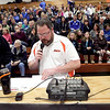 Neil Currie announces the St. Charles East boys varsity basketball team before Friday's game against St. Charles North.
