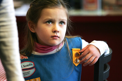 Monica Maschak - mmaschak@shawmedia.com Cameron Larsen watches television in the Fox River Grove Jimano's Pizzeria as she waits for the rest of her daisy girl scout troop 1206 to arrive so that they can start making pizzas on Wednesday, January 23, 2013.