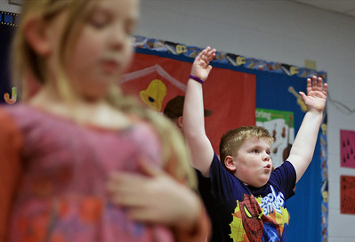 Sarah Nader - snader@shawmedia.com Wyatt Vandevoorde, 7, of Algonquin participates in a Zumba while attending Action to End Alzheimer's at Eastview Elementary School in Algonquin Friday, January 25, 2013. The event features fun activities including, belly bumpers, laser tag dodge ball, snag golf and baggo. All proceeds will go directly to the Alzheimer's Association in the name of Barb Hinkle, a former member of Eastview's outstanding staff, who taught kindergarten for many years.