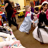 "Faith Christian Beginner School kindergartners Allison Mayer, Anna Heredia and McKinley Van dance during their class celebration of the wedding of ""Q"" and ""U"" Thursday afternoon."