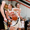 Laney Deckrow of St. Charles East looks for an opening during their game Tuesday night against Streamwood.
