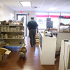 Fred Krause walks to the front of his shop, Trains by Fred in Batavia, as his dog, Bowie, follows close behind.