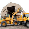 Geneva Public Works employee Steve Smith uses a front loader to fill a truck with salt at the public works facility Wednesday afternoon.
