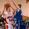 Batavia''s Luke Horton(52) tries to get around Larkin's Jason Barnhart during their game at Batavia Thursday night.