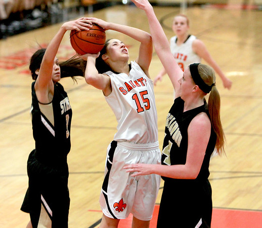 St. Charles East's Kyra Washington has her shot blocked by Streamwood's defense during their game Tuesday night at East.