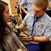 St. Charles North senior Stephen Coomes, a student at the Fox Valley Career Center, checks Kaneland High School student Ashley Castllanos' blood pressure during a wellness fair at Kaneland Tuesday.