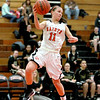 St. Charles East's Carly Pottle jumps to keep the ball from going out of bounds during their home game against Streamwood Tuesday night.