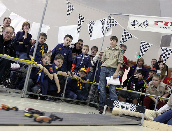 Jeff Krage – For the Kane County Chronicle<br /> Boyscouts, Cubscout and their families watch a race during Saturday's Pinewood Derby at Congregational Church in St. Charles.<br /> St. Charles 1/26/13