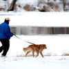 A man runs with his dog along the Fox River in St. Charles Friday morning.