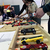 Jeff Krage – For the Kane County Chronicle<br /> Cars are selected for the next race during Saturday's Pinewood Derby at Congregational Church in St. Charles.<br /> St. Charles 1/26/13