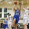 Geneva's Kelly Gordon (20) drives past Streamwood's Deja Moore (23) and Hannah McGlone (44) for a basket at Streamwood HighSchool in Streamwood, IL on Friday, January 25, 2013 (Sean King for The Kane County Chronicle)