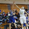 Geneva's Abby Novak (42) lays the ball up against Streamwood's Jessica Cerda (30) at Streamwood HighSchool in Streamwood, IL on Friday, January 25, 2013 (Sean King for The Kane County Chronicle)