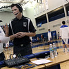 Jeff Krage — For the Kane County Chronicle<br /> Geneva High School junior's Jack Housenga, left, and Kevin McCarthy discuss boys basketball in front of their booth before the start of Friday's game against visiting St. Charles East.<br /> Geneva 1/25/13