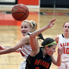 Jeff Krage – For the Kane County Chronicle<br /> St. Charles East's Katie Claussner swats the basketball out of the hands of Batavia's Jenny Welday during Saturday's game in St. Charles.<br /> St. Charles 1/26/13