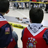 Jeff Krage – For the Kane County Chronicle<br /> Two Cubscouts from Den 3 watch a race during Saturday's Pinewood Derby at Congregational Church in St. Charles.<br /> St. Charles 1/26/13