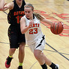 Jeff Krage – For the Kane County Chronicle<br /> St. Charles East's Amanda Hilton drives toward the basket around Batavia's Miranda Grizaffi during Saturday's game in St. Charles.<br /> St. Charles 1/26/13