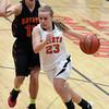 Jeff Krage – For the Kane County Chronicle<br /> St. Charles East's Amanda Hilton drives toward the basket around Batavia's Miranda Grizaffi during Saturday's game in St. Charles.<br /> St. Charles 1/26/13