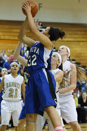 Geneva's Sidney Santos (32) shoots over Streamwood's Holly Foret at Streamwood HighSchool in Streamwood, IL on Friday, January 25, 2013 (Sean King for The Kane County Chronicle)