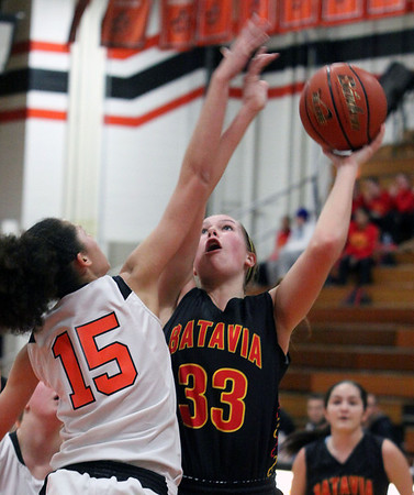 Jeff Krage – For the Kane County Chronicle<br /> Batavia's Erin Bayram is fouled by St. Charles East's Kyra Washington during Saturday's game in St. Charles.<br /> St. Charles 1/26/13