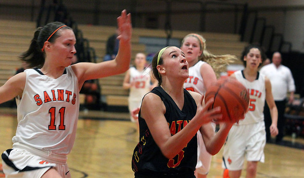 Jeff Krage – For the Kane County Chronicle<br /> St. Charles East's Carly Pottle attempts to bloack a shot by Batavia's Liza Fruendt during Saturday's game in St. Charles.<br /> St. Charles 1/26/13