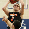 Jeff Krage — For the Kane County Chronicle<br /> St. Charles East's Dom Adduci takes a shot during Friday's game at Geneva.<br /> Geneva 1/25/13